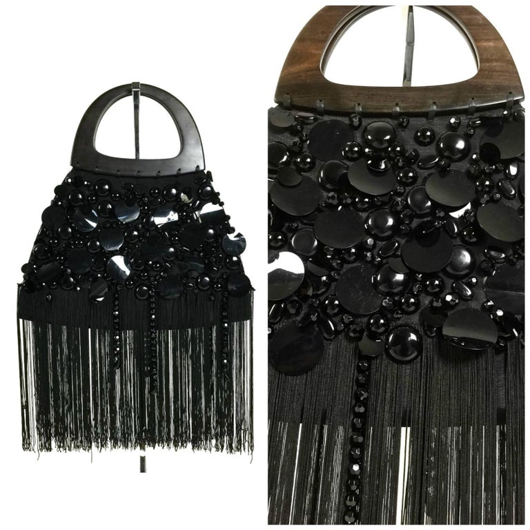 Vintage YSL Yves Saint Laurent Disc Beaded Fringe Wood Top Handle Hand Bag  Measurements: Total Height: 24 inches (60.96 cm) handle and fringes included Width: 14 6/8 inches (37.46 cm) Depth: 2 2/8 inches (5.71 cm)  Features: - 100% Authentic YVES