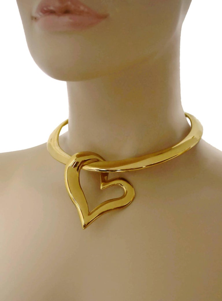 Vintage YSL Yves Saint Laurent Heart Pendant Rigid Choker Necklace  Measurements: Height: 4 inches (10 cm) Width: 2.5 inches (6.3 cm) Diameter: 10.23 inches (26 cm)  Features: - 100% Authentic YVES SAINT LAURENT. - Massive heart pendant on a rigid