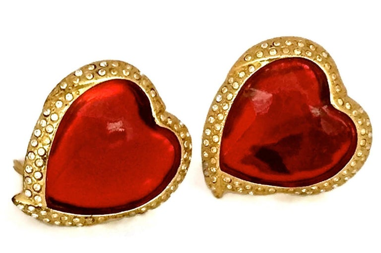 Vintage YSL Yves Saint Laurent Red Faceted Heart Rhinestone Earrings  Measurements: Height: 1.5 inches (3.81 cm) Width: 1.3 inches (3.4 cm)  Features: - 100% Authentic Yves Saint Laurent. - Raised faceted red heart surrounded with rhinestones. -