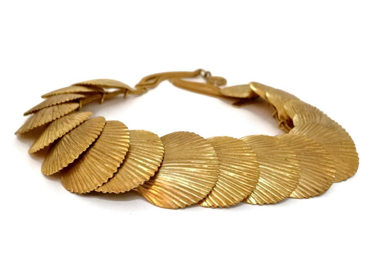 Vintage YSL Yves Saint Laurent Robert Goossens Scallop Shell Choker Necklace  Measurements: Height: 1.02 inches (2.6 cm) Wearable Length: 14.17 inches (36 cm)  Features: - 100% Authentic YVES SAINT LAURENT. - Textured scallop shell link necklace. -