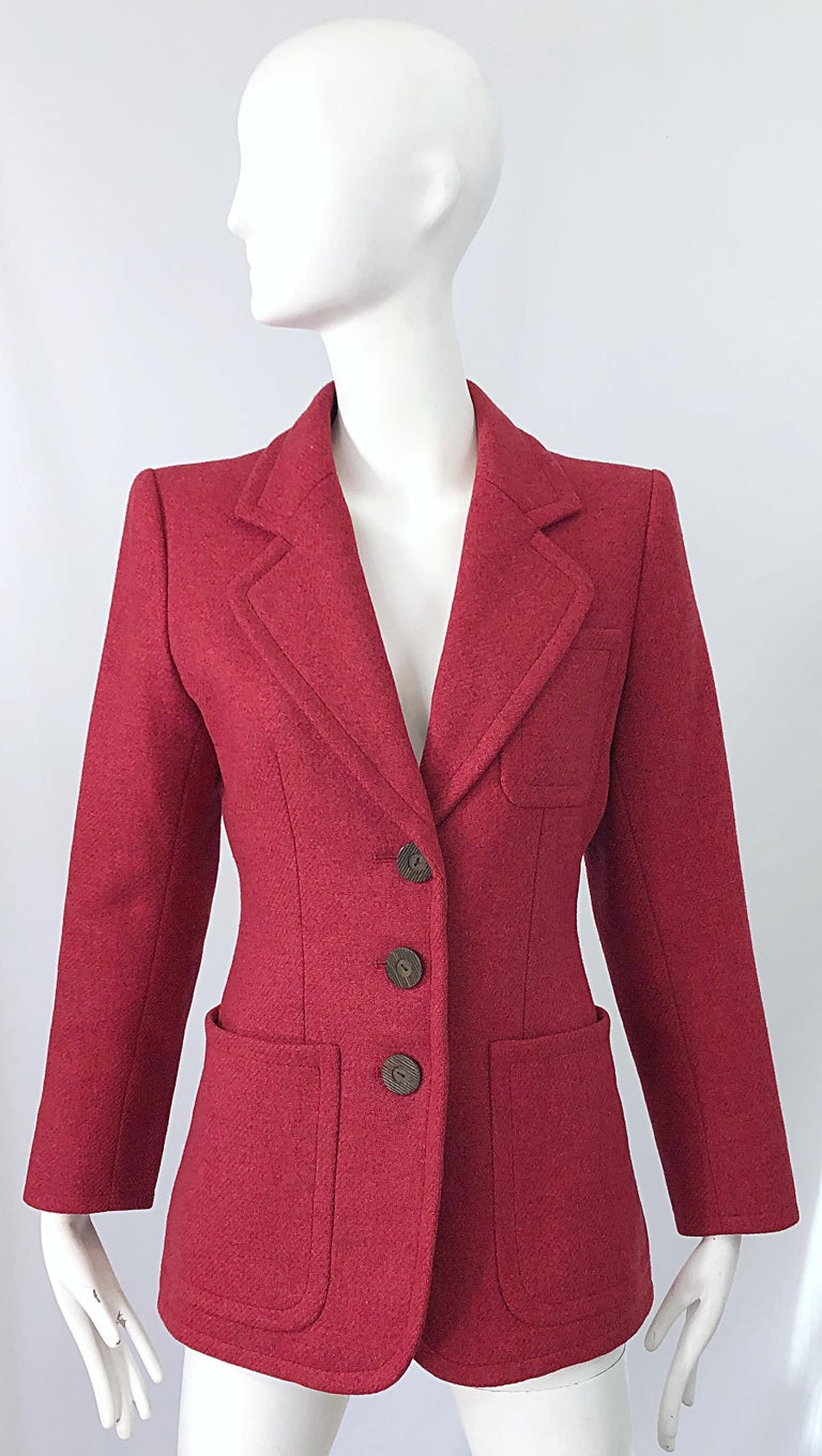 Stylish and timeless vintage 90s YVES SAINT LAURENT Rive Gauche raspberry pink tailored blazer jacket ! Features the perfect pink color that is great anytime of year. Classic Saint Laurent lapels that are reminiscent of his designs from the 70s.