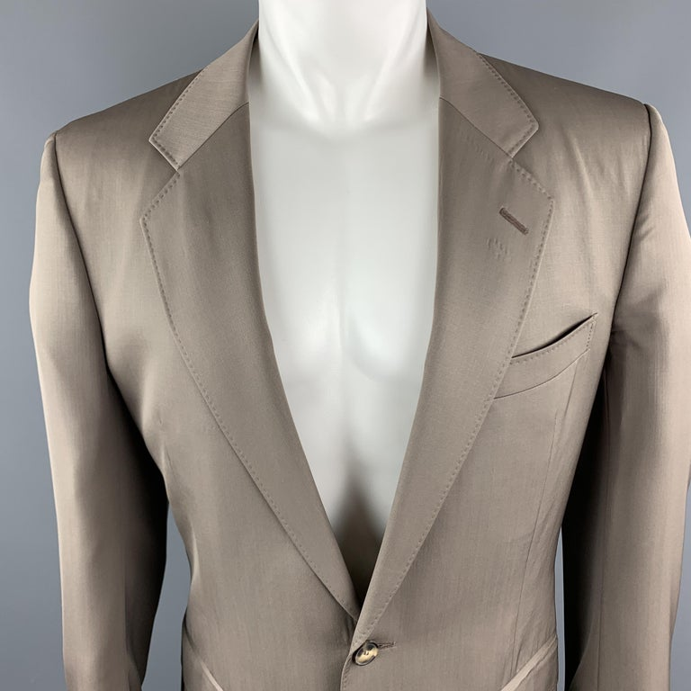 Vintage YVES SAINT LAURENT Rive Gauche suit comes in a taupe wool and includes a single breasted, two button sport coat with a notch lapel and matching flat front trousers. Made in Switzerland.   Excellent Pre-Owned Condition. Marked: 52
