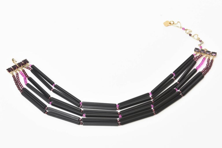 This rare, ultra chic and vintage hallmarked Yves Saint Laurent 6 strand necklace is purple and black glass. This is a very special necklace of the french fashion master. It is hallmarked