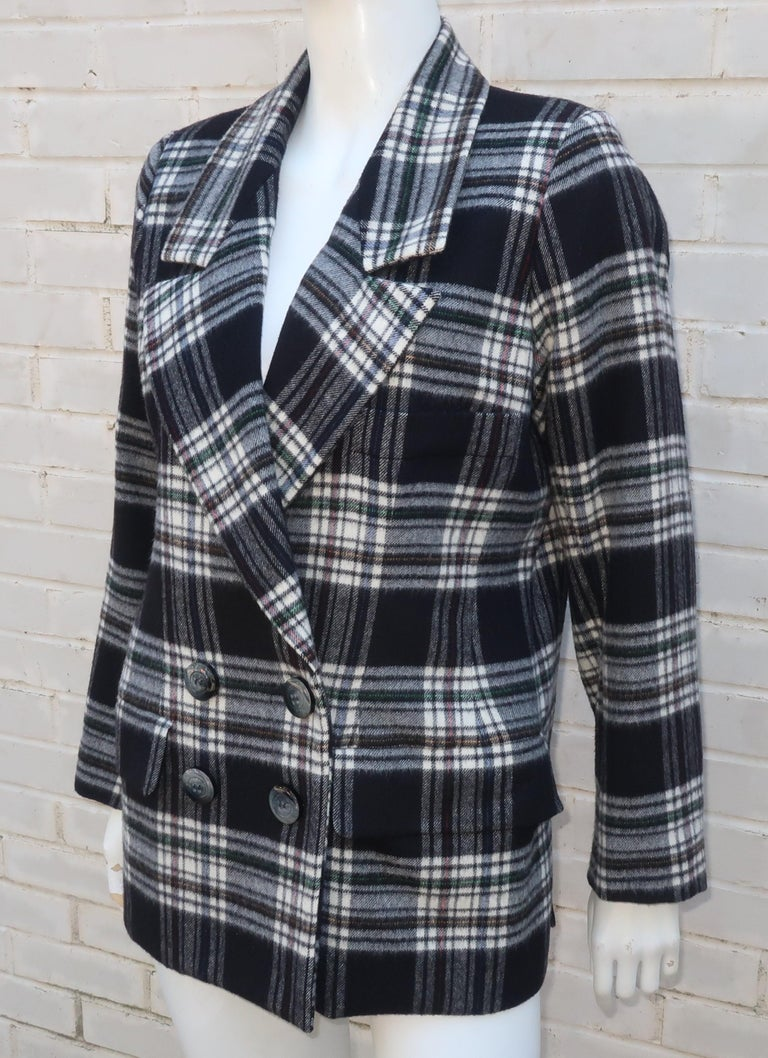 Yves Saint Laurent Rive Gauche plaid wool double breasted jacket in black & white with skinny stripes of red, blue and green.  The menswear style silhouette offers front flap pockets and a breast pocket with generous lapels.  The buttons, both at