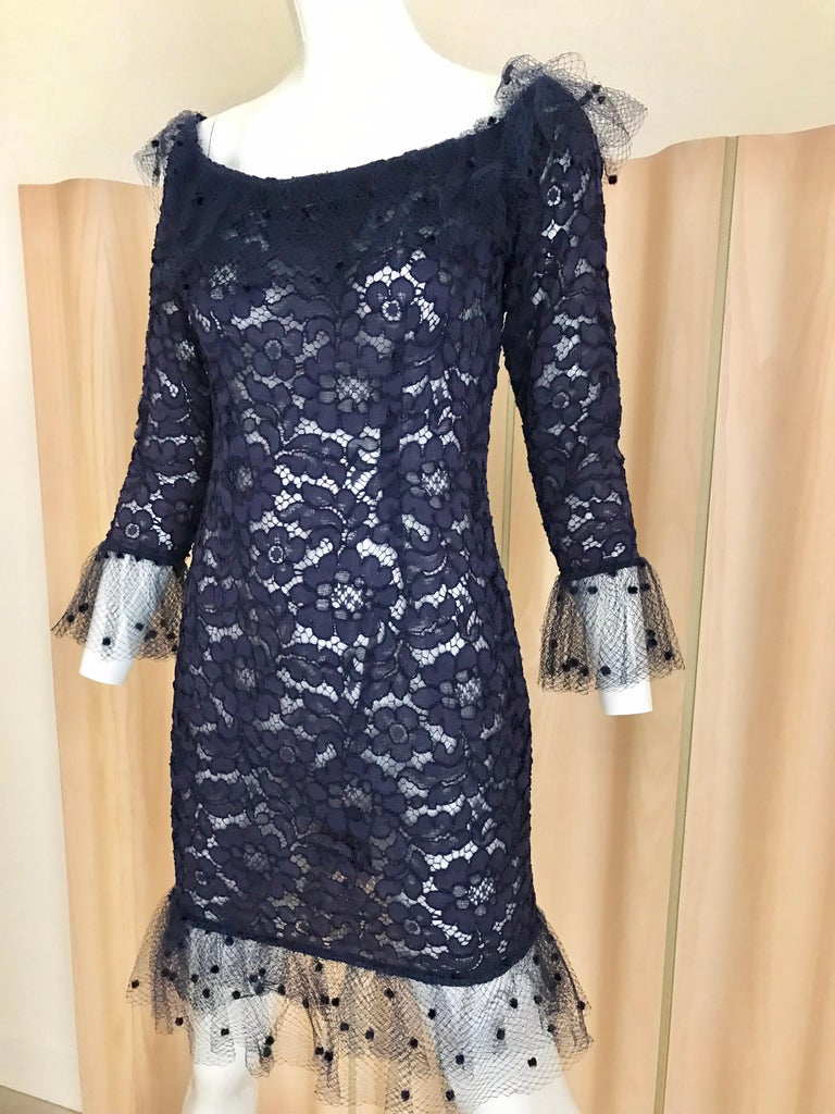 Chic Vintage Yves Saint Laurent Blue Lace sheath cocktail dress with delicate tulle netting lace on collar and sleeves. Perfect cocktail dress. Size: 4