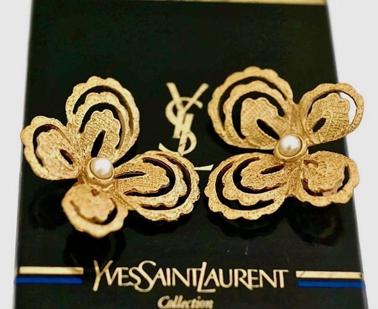 Vintage YVES SAINT LAURENT Butterfly Earrings by Robert Goossens  Measurements: Height: 1 5/8 inches Width: 1 6/8 inches  Features: - 100% Authentic YVES SAINT LAURENT. - Intricate gilt metal hardware in gold tone. - Embellished with faux pearls. -