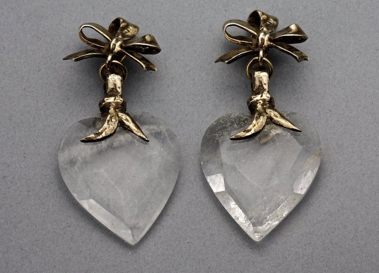 Vintage YVES SAINT LAURENT by Robert Goossens Bow Glass Heart Dangling Earrings  Measurements: Height: 3.11 inches (7.9 cm) Width: 1.38 inches (3.5 cm) Weight: 23 grams  Features: - 100% Authentic YVES SAINT LAURENT. - Bow gilt metal with dangling