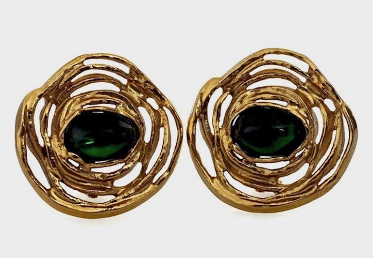 Vintage YVES SAINT LAURENT by Robert Goossens Emerald Flower Earrings  Measurements: Height: 1 6/8 inches Width: 1 7/8 inches  Features: - 100% Authentic YVES SAINT LAURENT by Robert Goossens. - Emerald oval poured glass/ resin center piece. - Swirl