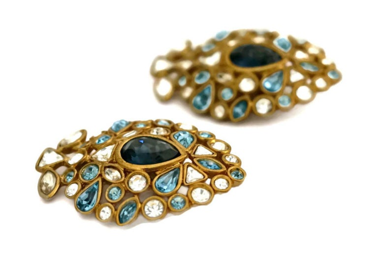 Vintage YVES SAINT LAURENT by Robert Goossens Multi Jewelled Earrings  Measurements: Height: 1 2/8 inches Width: 1 6/8 inches  Features: - 100% Authentic YVES SAINT LAURENT. - Rhinestones are in shades of Crystal, Light Sapphire, Light Rose and