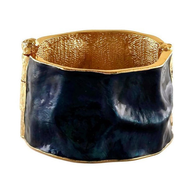 Vintage YVES SAINT LAURENT by Robert Goossens Wrinkled Enamel Cuff Bracelet  Measurements: Height: 1 6/8 inches (4.44 cm) Inner Circumference: 7 inches (17.78 cm)  Features: - 100% Authentic YVES SAINT LAURENT by Robert Goossens . - Blue enamel