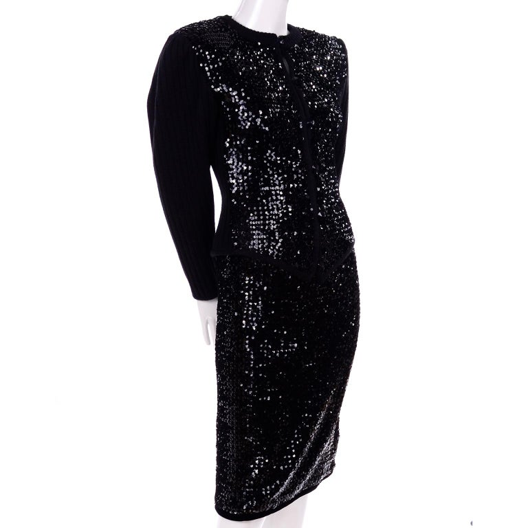 This is a wonderful Yves Saint Laurent 2 piece evening outfit that would make a great evening dress alternative. The early 1980's evening suit includes a beautiful knit sweater with a ribbed back and a heavily sequined front and a slim skirt covered