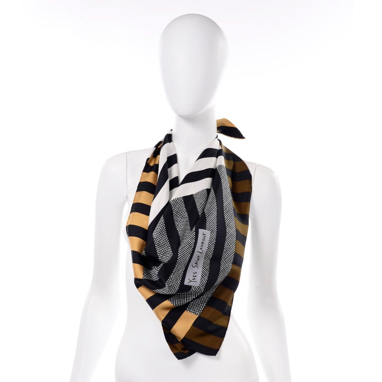 We love Yves Saint Laurent vintage scarves and this one is so modern with its geometric lines running in various directions.  The scarf has hand rolled edges and has the Yves Saint Laurent signature in the print.. No tags or labels. We guarantee