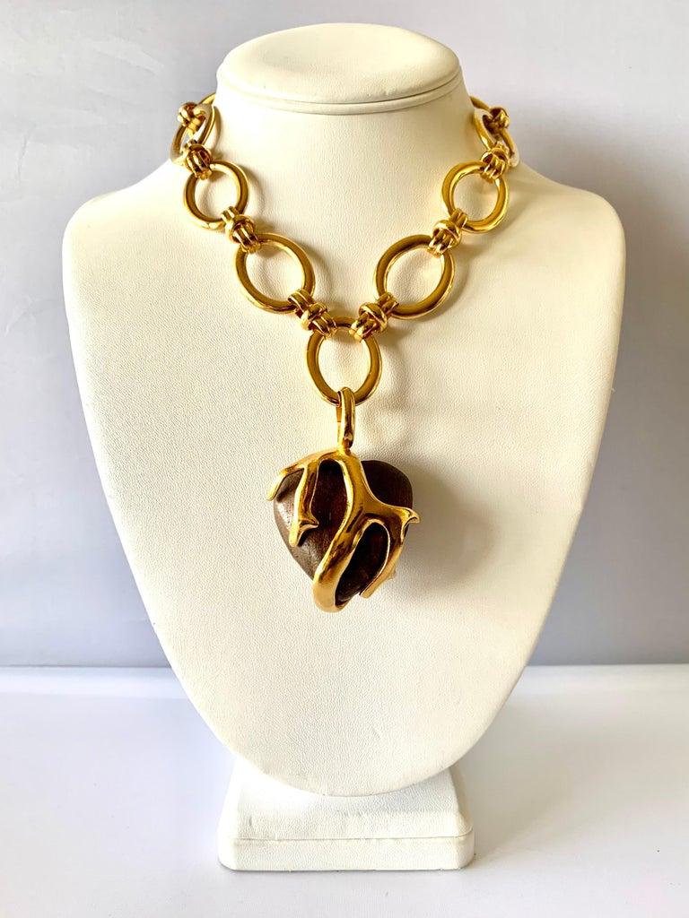 Scarce vintage Yves Saint Laurent heart-shaped pendant necklace comprised out of gilt metal
