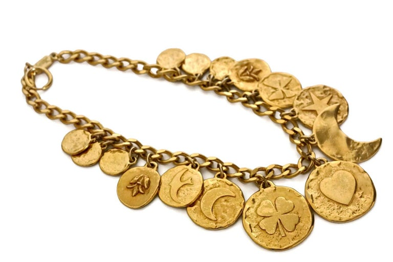 Vintage YVES SAINT LAURENT Iconic Charm Necklace  Measurements: Height: 2 1/8 inches Wearable Length: 17 inches (maximum)  Features: - 100% Authentic YVES SAINT LAURENT. - Chunky discs with iconic heart, star, moon and clover symbols. - Adjustable