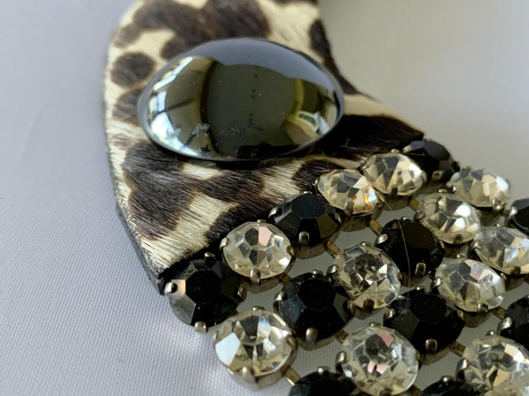 Unusual Yves Saint Laurent leopard black and clear diamante rhinestones necklace. The necklace is comprised out of pony hair leather in a leopard print collar with four rows of black and clear faceted glass rhinestones at the center - accenting the