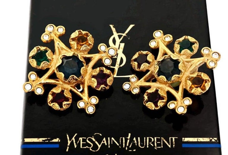 Vintage YVES SAINT LAURENT Multi Colored Stone Earrings  Measurements: Height: 1 7/8 inches Width: 1 7/8 inches  Features: - 100% Authentic YVES SAINT LAURENT. - Inverted square with multi colored stones and clear rhinestones at the corners. -