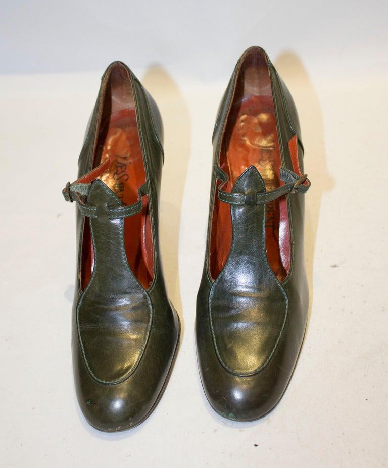A lovely pair of vintage leather shoes by Yves Saint Laurent Paris. In an olive green colour the shoes have a 4'' heel, and are style 7521M, size US8.