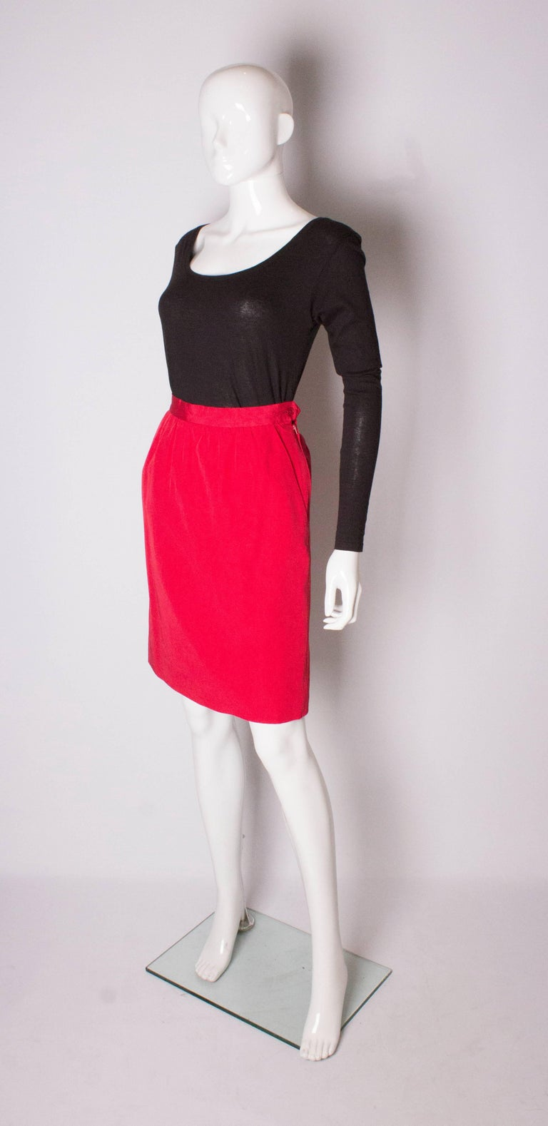 A chic vintage skirt by Yves Saint Laurent, Rive Gauche line. The skirt is a cotton and viscose mix ( 53% cotton, 47% viscose). It has sloping pockets on each side , gathering at the waist and a zip on the left hand side.