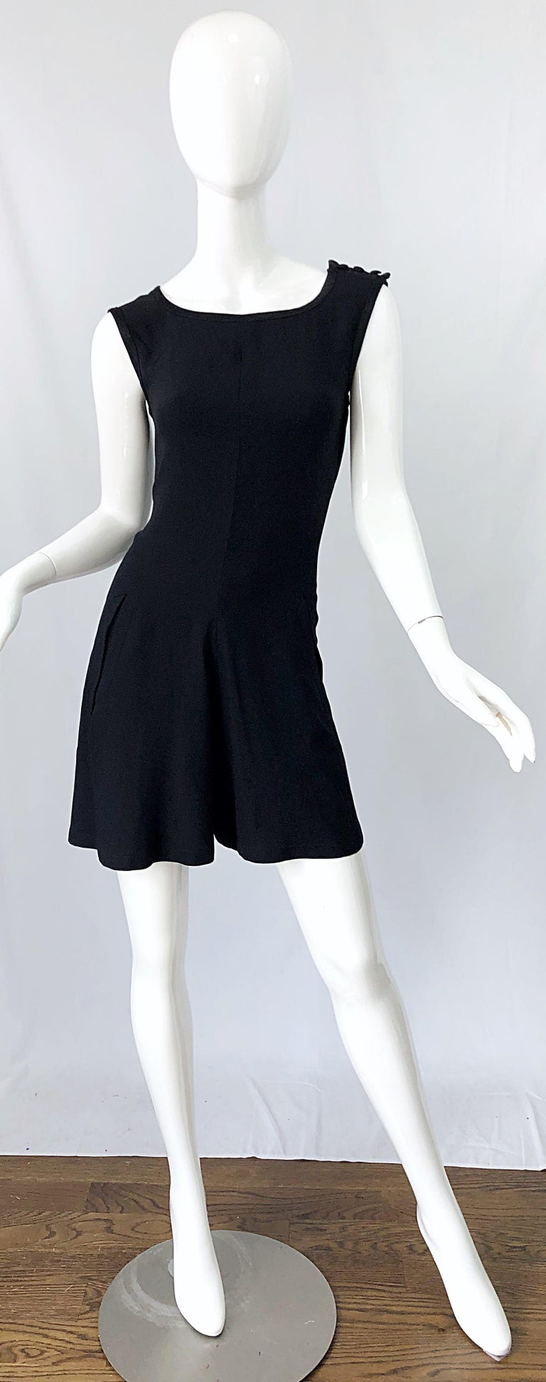 What's better than a little black dress? A vintage early 90s YVES SAINT LAURENT YSL Rive Gauche black sleeveless rayon romper / jumpsuit / playsuit ! Features a tailored bodice with wide legs. PCOKETS at each side of the hips. Hidden zipper up the
