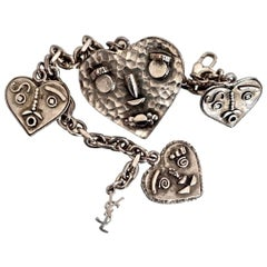 Vintage YVES SAINT LAURENT Steampunk Heart Faces Charm Bracelet