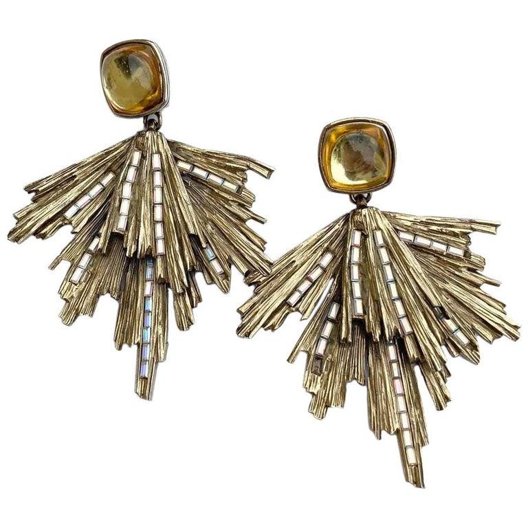 Vintage YVES SAINT LAURENT Stud Earrings in Gilt Metal and Rhinestones For Sale