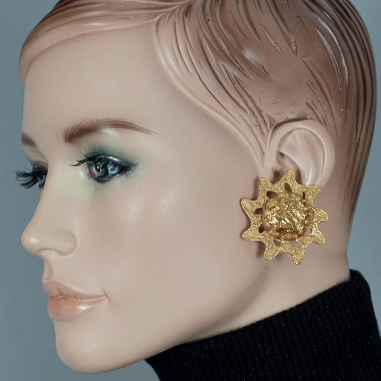 Vintage YVES SAINT LAURENT Sun Nugget by Robert Goossens Earrings  Measurements: Height: 1.73 inches (4.4 cm) Width: 1.73 inches (4.4 cm) Weight per Earring: 19 grams  Features: - 100% Authentic YVES SAINT LAURENT. - Chunky sun with raised textured
