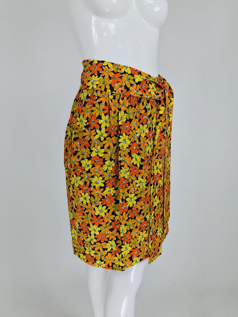 Vintage Yves Saint Laurent Rive Gauche vibrant floral silk print wrap skirt. This beautiful skirt is simple and elegant in style, a banded, gathered waist, the skirt wraps and closes with two bar hook at the front waist side. Together with the self
