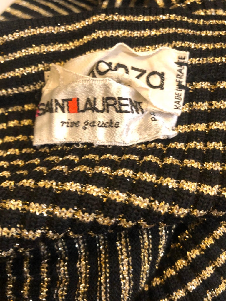 Fabulous 1970s YVES SAINT LAURENT Rive Gauche metallic gold and black striped knit strapless dress or maxi skirt! Soft stretchy knit material has a lot of give, so this can literally fit nearly any size. Simply slips on and stretches to fit. Can