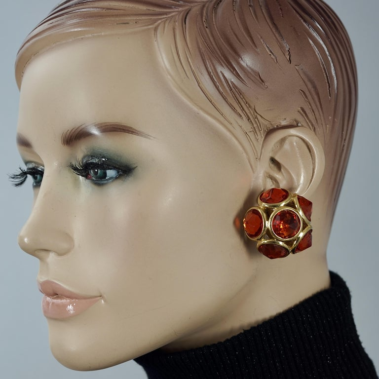 Vintage YVES SAINT LAURENT Ysl Amber Flower Earrings  Measurements: Height: 1.37 inches (3.5 cm) Width: 1.37 inches (3.5 cm) Depth: 0.86 inch (2.2 cm) Weight per Earring: 18 grams  Features: - 100% Authentic Yves Saint Laurent. - Faceted stones in