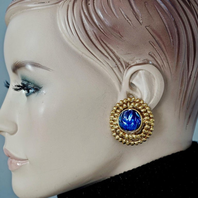 Vintage YVES SAINT LAURENT Ysl Blue Resin Poured Disc Earrings  Measurements: Height: 1.57 inches (4 cm) Width: 1.50 inches (3.81 cm) Weight per Earring: 22 grams  Features: - 100% Authentic YVES SAINT LAURENT. - Dramatic irregular depth poured