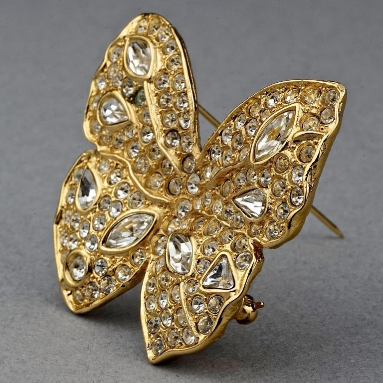 Vintage YVES SAINT LAURENT Ysl Butterfly Rhinestone Brooch  Measurements: Height: 1.65 inches (4.2 cm) Width: 1.81 inches (4.6 cm)  Features: - 100% Authentic YVES SAINT LAURENT. - Butterfly brooch studded with rhinestones. - Signed YSL Made in
