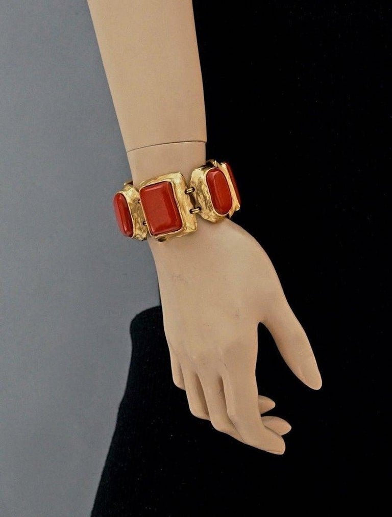Vintage YVES SAINT LAURENT Ysl Chunky Geometric Coral Cabochon Bracelet  Measurements: Height: 1.45 inches (3.7 cm) Wearable Length: 6.37 inches (16.2 cm)  Features: - 100% Authentic YVES SAINT LAURENT. - Chunky geometric coral cabochon links. -