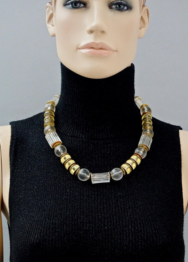 Vintage YVES SAINT LAURENT Ysl Citrine Clear Lucite Necklace  Measurements: Height: 0.70 inch (1.8 cm) Length: 21.25 inches (54 cm) to 22.24 inches (56.5 cm)  Features: - 100% Authentic YVES SAINT LAURENT. - Lucite resin in clear and citrine