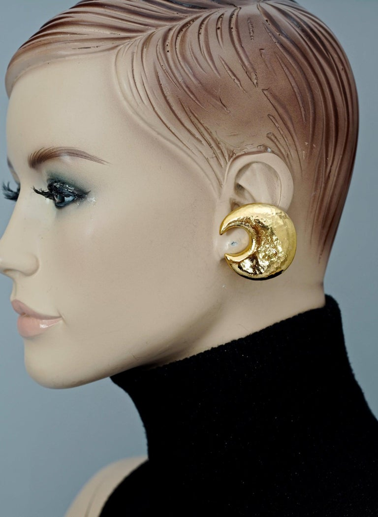 Vintage YVES SAINT LAURENT Ysl Crescent Moon Earrings  Measurements: Height: 1.5 inches (3.8 cm) Width: 1.45 inches (3.7 cm) Weight per Earring: 15 grams  Features: - 100% Authentic YVES SAINT LAURENT. - Textured crescent/ moon earrings. - Gold tone