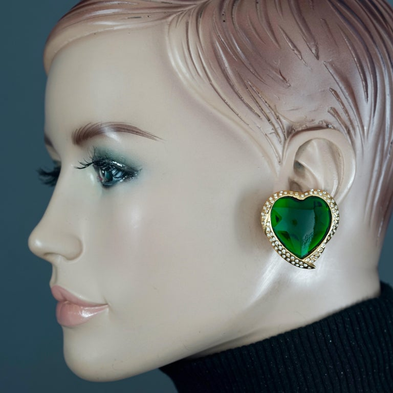 Vintage YVES SAINT LAURENT Ysl Emerald Green Faceted Heart Rhinestone Earrings  Measurements: Height: 1.42 inches (3.6 cm) Width: 1.38 inches (3.5 cm) Weight per Earring: 16 grams  Features: - 100% Authentic YVES SAINT LAURENT. - Raised faceted