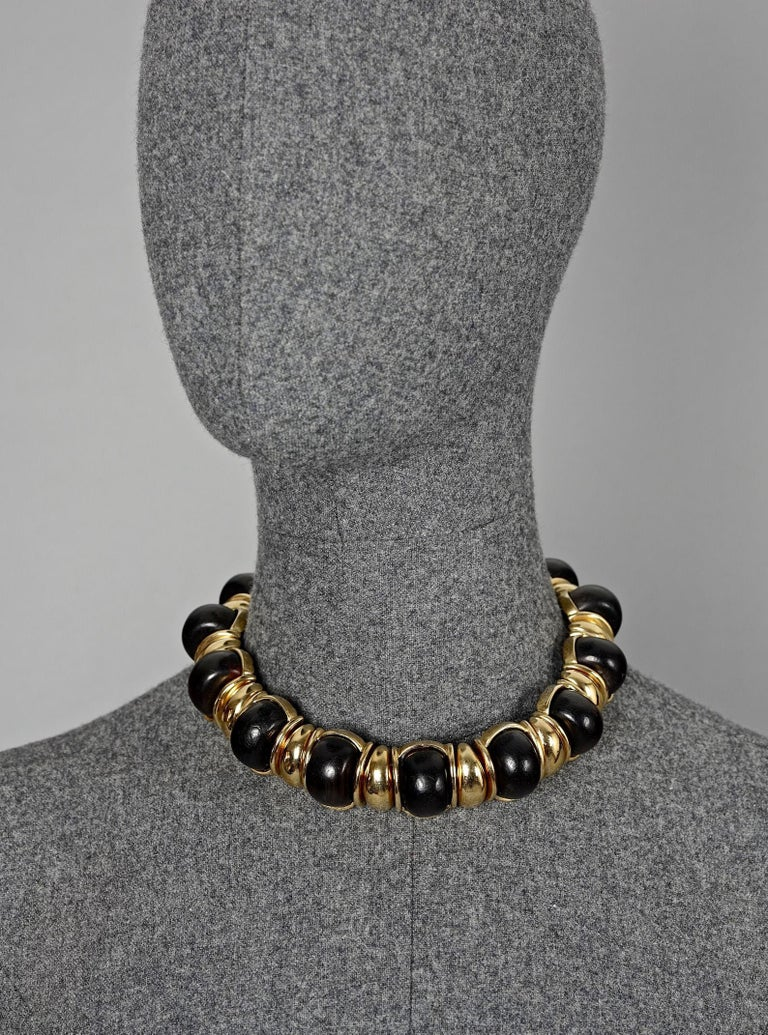 Vintage YVES SAINT LAURENT Ysl Exotic Wood Link Choker Necklace  Measurements: Centre Wood Medallion: 1.06 inches (2.7 cm) Wearable Length: 15.55 inches (39.5 cm)  Features: - 100% authentic YVES SAINT LAURENT. - Exotic wood articulated metal