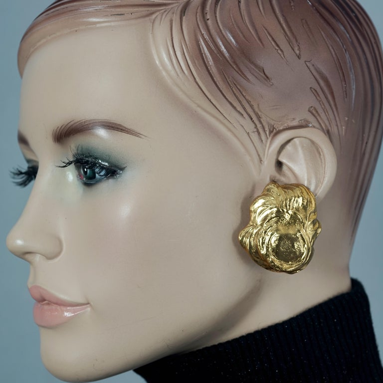Vintage YVES SAINT LAURENT Ysl Free Form Earrings  Measurements: Height: 1.65 inches (4.2 cm) Width: 1.49 inches (3.8 cm) Weight per Earring: 24 grams  Features: - 100% YVES SAINT LAURENT. - Free form textured earrings. - Signed YSL. - Clipback