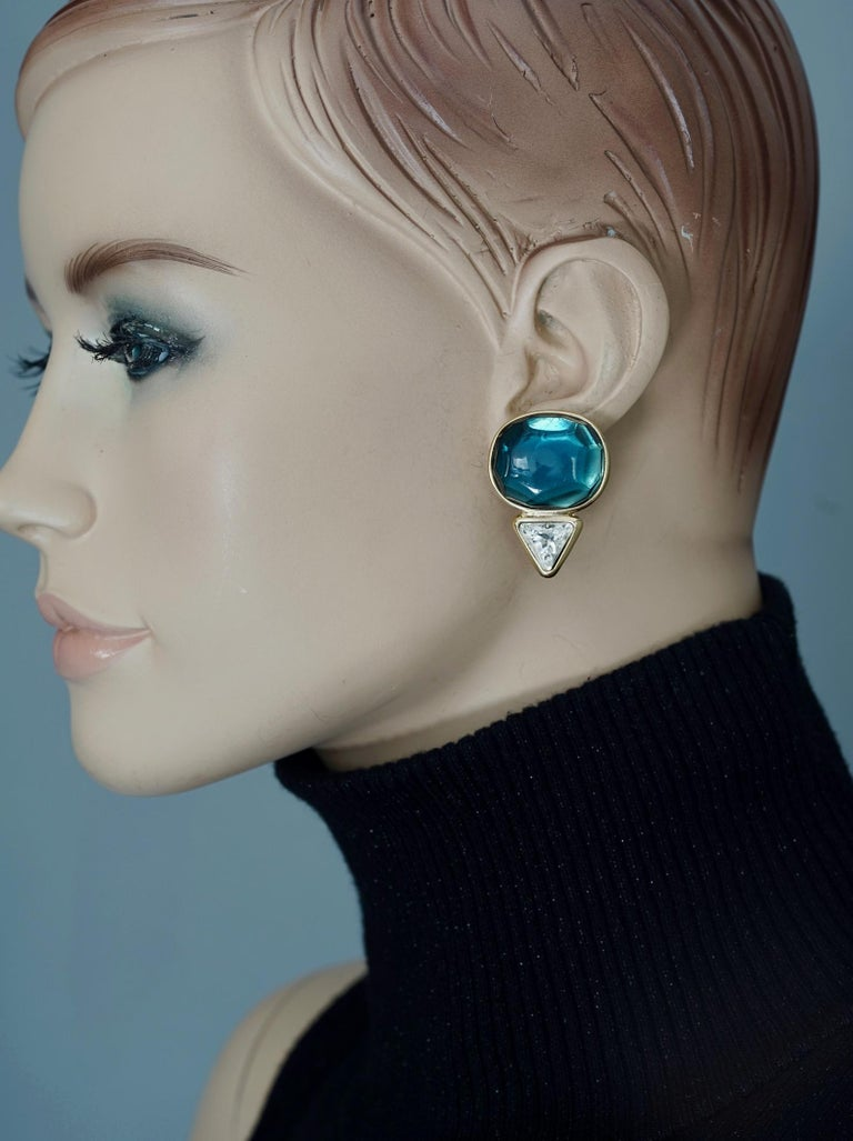 Vintage YVES SAINT LAURENT Ysl Geometric Blue Faceted Stone Earrings  Measurements: Height: 1 1/2 inches (3.81 cm) Width: 1 inch (2.54 cm)  Features: - 100% Authentic YVES SAINT LAURENT. - Geometric style in gold tone hardware. - Faceted faux blue