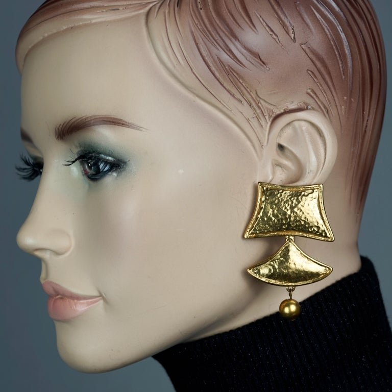Vintage YVES SAINT LAURENT Ysl Geometric Tiered Earrings  Measurements: Height: 2.44 inches (6.2 cm) Width: 1.65 inches (4.2 cm) Weight per Earring: 22 grams  Features: - 100% Authentic YVES SAINT LAURENT. - 3 Tiered hammered gilt geometric dangling