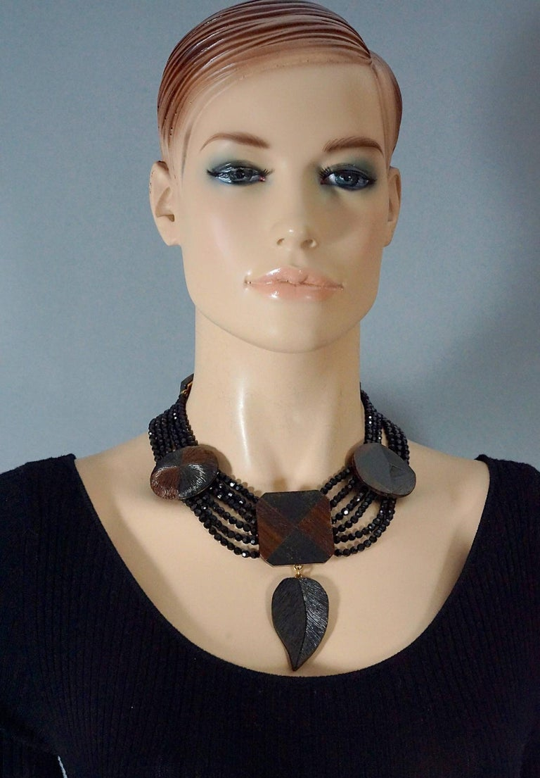 Vintage YVES SAINT LAURENT Ysl Geometric Wood Marquetry Multi Layer Bead Necklace  Measurements: Centrepiece Height: 4.13 inches (10.5 cm) Wearable Length: 15.35 inches (39 cm) to 17.32 inches (44 cm)  Features: - 100% Authentic YVES SAINT