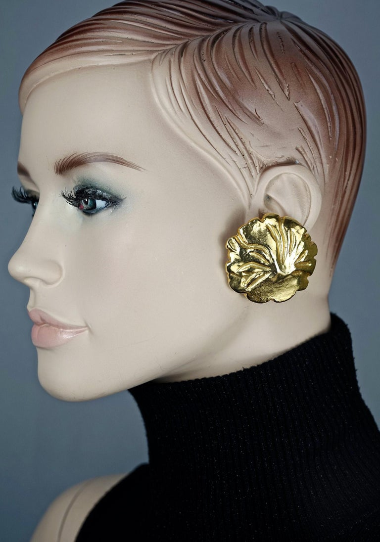 Vintage YVES SAINT LAURENT Ysl Gilt Flower Earrings  Measurements: Height: 1.77 inches (4.5 cm) Width: 1.85 inches (4.7 cm) Weight per Earring: 18 grams  Features: - 100% Authentic YVES SAINT LAURENT. - Chunky gilt flower earrings. - Clip back