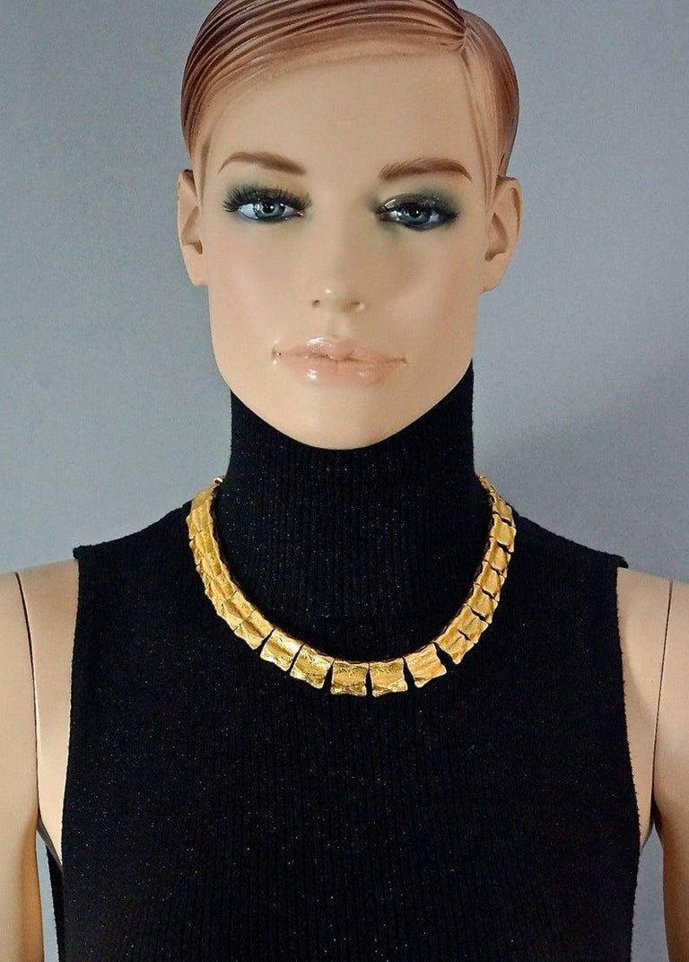 Vintage YVES SAINT LAURENT Ysl Hammered Gilt Flap Charm Necklace  Measurements: Height: 0.59 inch (1.5 cm) Wearable Length: 17.12 inches to 18.30 inches (43.5 cm to 46.5 cm)  Features: - 100% authentic YVES SAINT LAURENT. - Hammered gilt flap