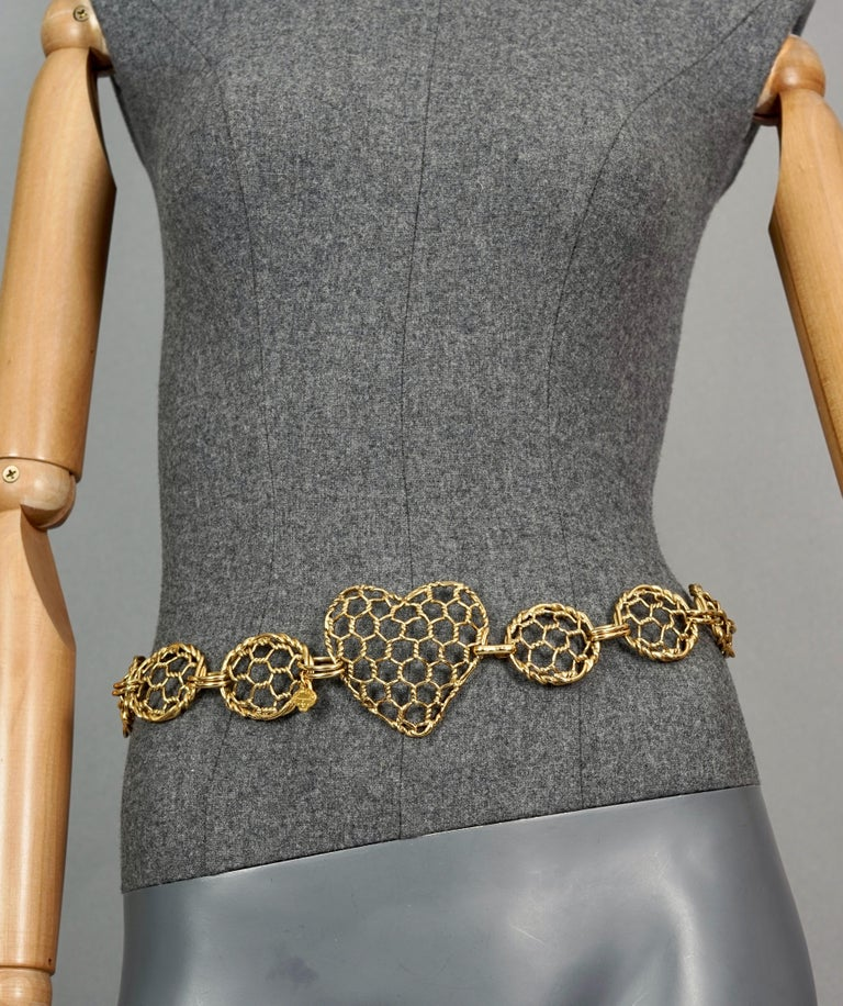 Vintage YVES SAINT LAURENT Ysl Heart Mesh Link Belt  Measurements: Heart Buckle: 2.75 inches (7 cm) Oval Links: 1.45 inches (3.7 cm) Length: 27.95 inches (71 cm)  Features: - 100% Authentic YVES SAINT LAURENT. - Massive heart and oval mesh link