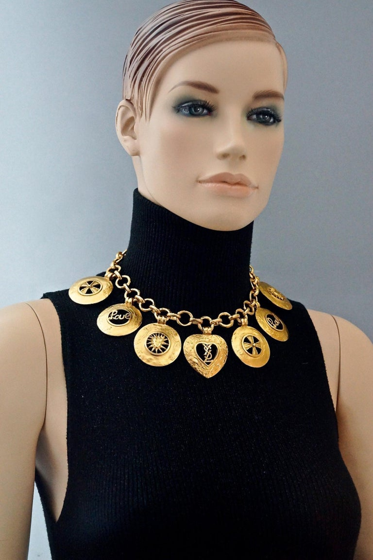 Vintage YVES SAINT LAURENT Ysl Iconic Emblem Disc Medallion Charm Necklace  Measurements: Height: 2.20 inches (5.6 cm) Wearable Length: 16.33 inches (41.5 cm) until 18.30 inches (46.5 cm)  Features: - 100% Authentic YVES SAINT LAURENT. - 7 Chunky