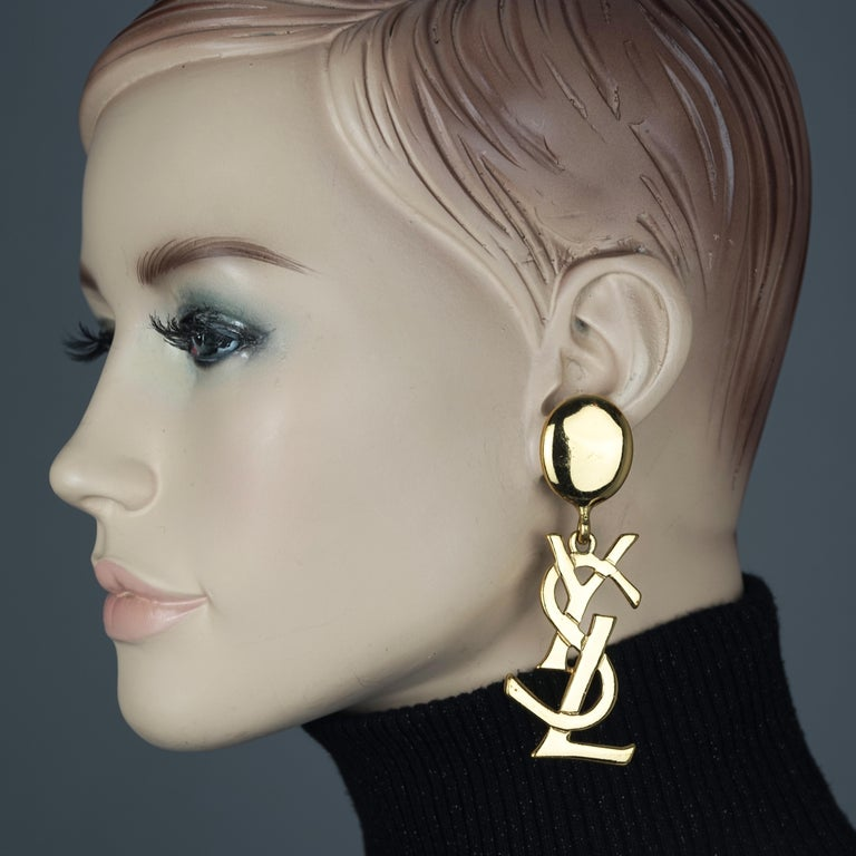 Vintage YVES SAINT LAURENT Ysl Iconic Logo Drop Earrings - Sex and The City As seen on Samantha Jones (Kim Cattrall) in Sex and the City movie.  Measurements: Height: 3.34 inches (8.5 cm) Width: 1.37 inches (3.5 cm) Weight per Earring: 17