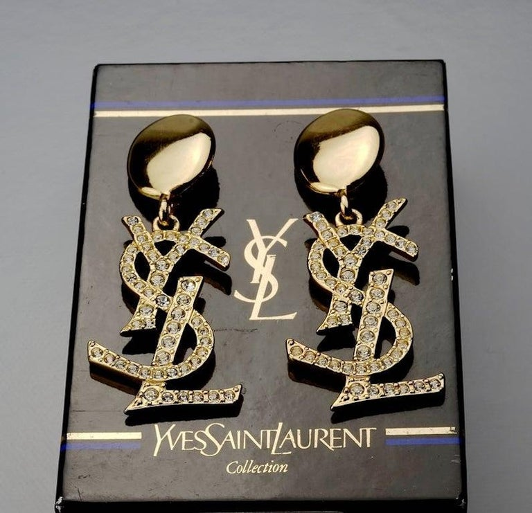 Vintage YVES SAINT LAURENT Ysl Iconic Logo Rhinestone Dangling Earrings - Sex and The City  Measurements: Height: 3.15 inches (8 cm) Width: 1.34 inches (3.4 cm) Weight per Earring: 21 grams  As seen on Samantha Jones (Kim Cattrall) in Sex and the