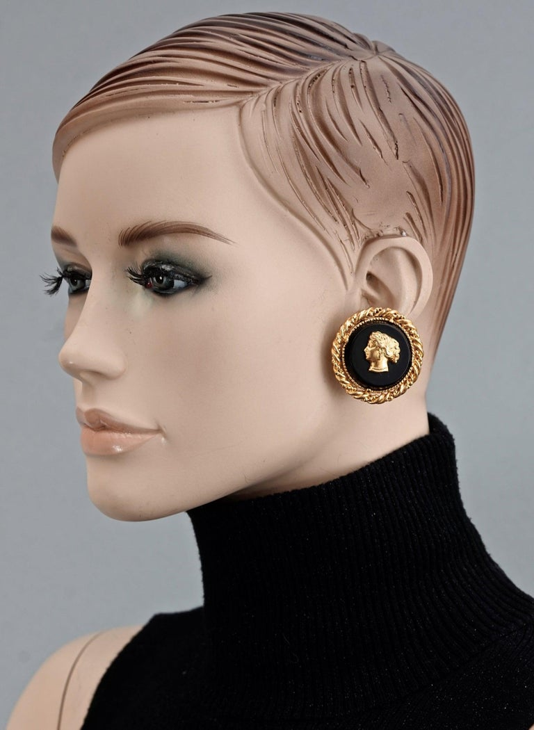 Vintage YVES SAINT LAURENT Ysl Lady Profile Cameo Earrings  Measurements: Height: 1.57 inches (4 cm) Width: 1.57 inches (4 cm) Weight per Earring: 20 grams  Features: - 100% Authentic YVES SAINT LAURENT. - Raised metal lady cameo on black resin