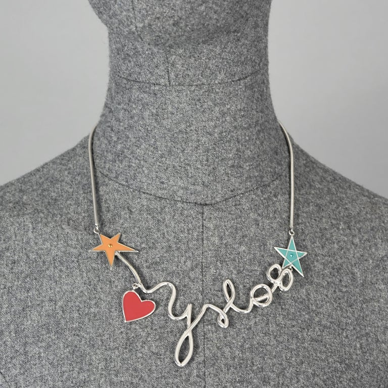 Vintage YVES SAINT LAURENT Ysl Logo Cursive Pop Heart Star Necklace  Measurements: Height: 1.77 inches (4.5 cm) letter Y Wearable Length: 14.96 inches (38 cm) to 18.11 inches (46 cm)  Features: - 100% Authentic YVES SAINT LAURENT. - YSL 08 in
