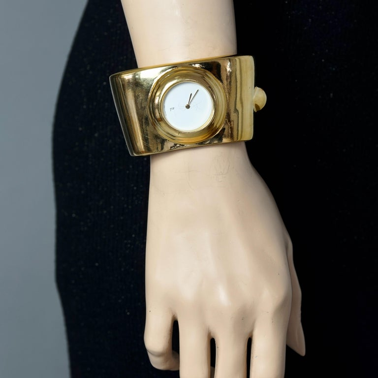 Vintage YVES SAINT LAURENT Ysl Logo Space Age Watch Clamper Cuff Bracelet   Measurements: Height: 1.73 inches (4.4 cm) Overall Circumference: 5.98 inches (15.2 cm) Horizontal Diameter: 3.03 inches (7.7 cm) Vertical Diameter: 2.40 inches (6.1