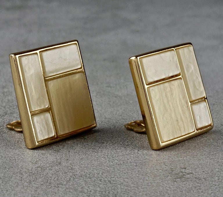 Vintage YVES SAINT LAURENT Ysl Mother of Pearl Mondrian Earrings  Measurements: Height: 1.26 inches (3.2 cm) Width: 1.26 inches (3.2 cm) Weight per Earring: 20 grams  Features: - 100% Authentic YVES SAINT LAURENT. - Square earrings in Piet Mondrian